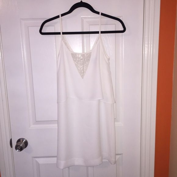 MANGO White Tier Spaghetti Strap Mini Dress Purchased about 2 years ago from Mango store at South Coast Plaza before the store closed. Paid around $40. Wore it only once for maybe less than an hour. Excellent condition, basically like brand new, no stains or rips or signs of wear. The size is XXS but it runs a little big and it fits more like an XS. NO TRADES!!! NO RETURNS!!! NO MODELING!!!! Mango Dresses Mini