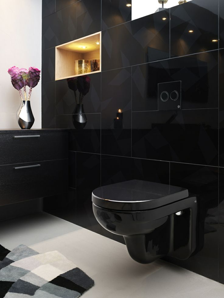 Vägghängd toalett från Artic med spolknapp i svart glas | GUSTAVSBERG
