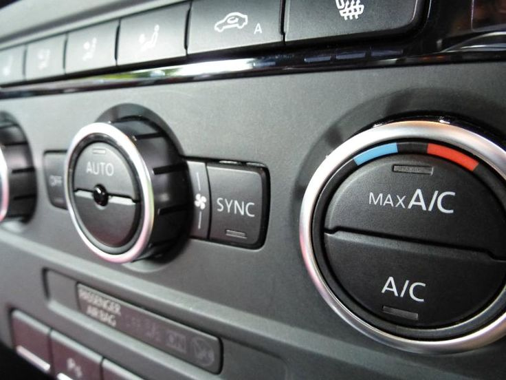 Air conditioning control dial on the dashboard in a car in a close up selective focus view - free stock photo from www.freeimages.co.uk