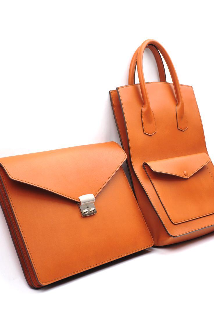 Orange leather document case and shopper.