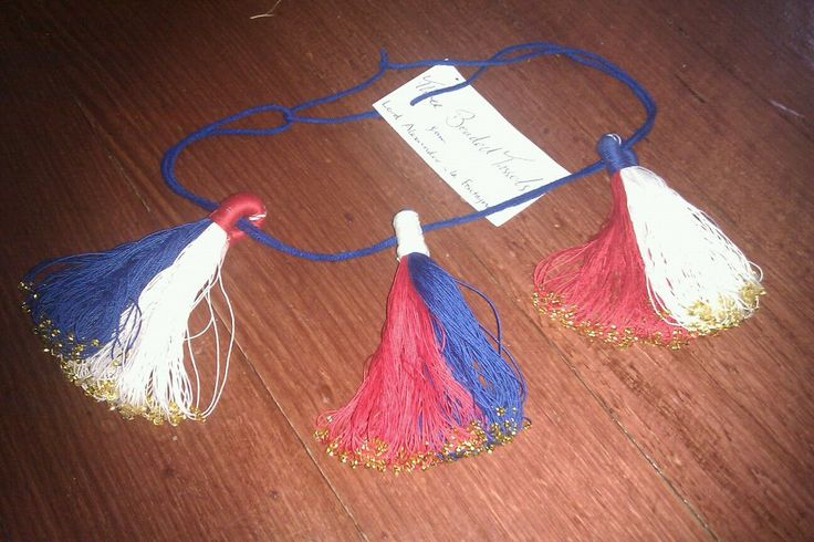 Three beaded tassels for donation to the Crown of Lochac. The top loops were done with button hole stitch.