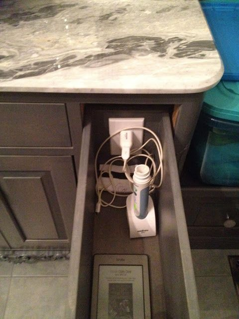 Master Bathroom Ideas: Keep Counters clean with this deep drawer and outlet to store power toothbrushes!