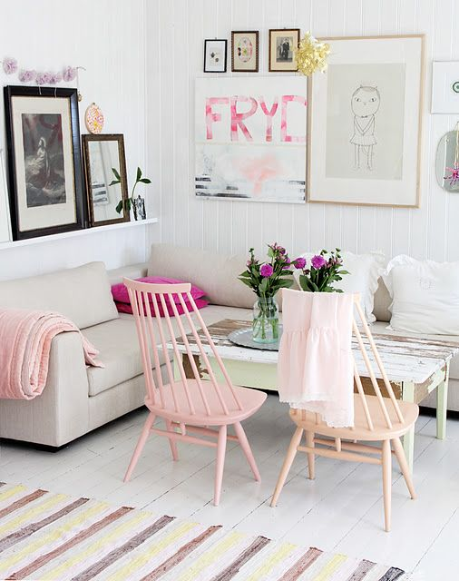 Love the shelves + art + couch & chair setup