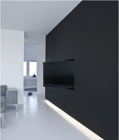 Camouflage your flat screen into a black wall.