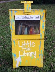 What a friendly bright yellow Little Library!