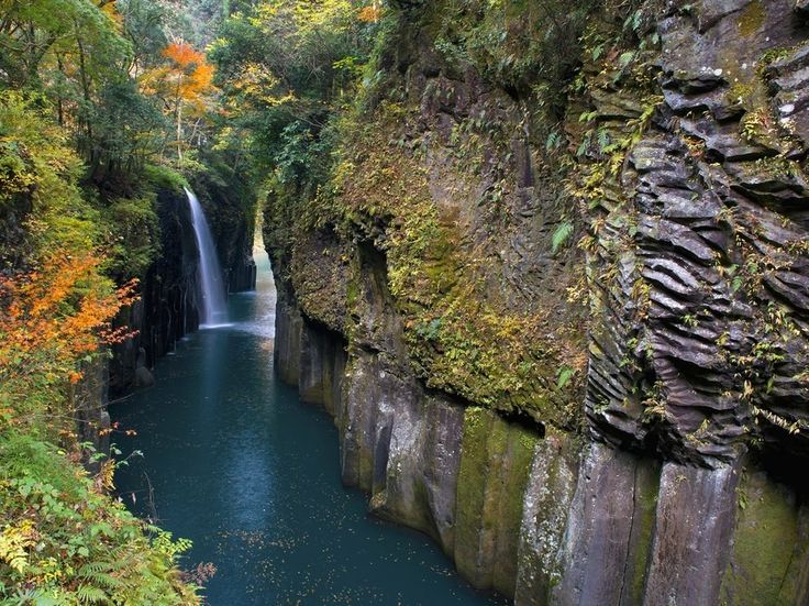 Japan offers many compelling places to view the foliage, but Takachiho Gorge in Miyazaki Prefecture may be the best. Rent a rowboat and cruise through the celadon waters framed by steep rock faces, past misty waterfalls, and under marigold leaves on the trees above. The landscape here is spectacular, the sides of the rock walls go from vertical and smooth to horizontal and jagged and present a natural timeline of the region's geology.