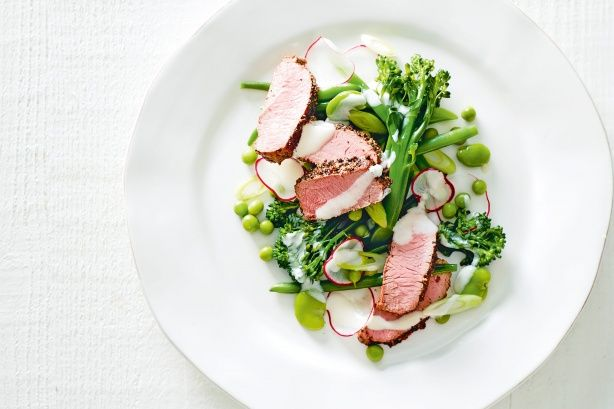 Spring vegetables with pepper-crusted lamb. Delicious Magazine Australia