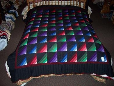 Amish Roman Stripe Quilt - I like this as a baby quilt (in more scrappy stripes) because the colors wear better than pastels.
