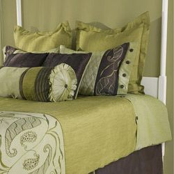 this bedding selection is an expression of ultimate extravagance. A light olive green and rich brown hues are layered with a mixture of patterns, surface textures and sheen.