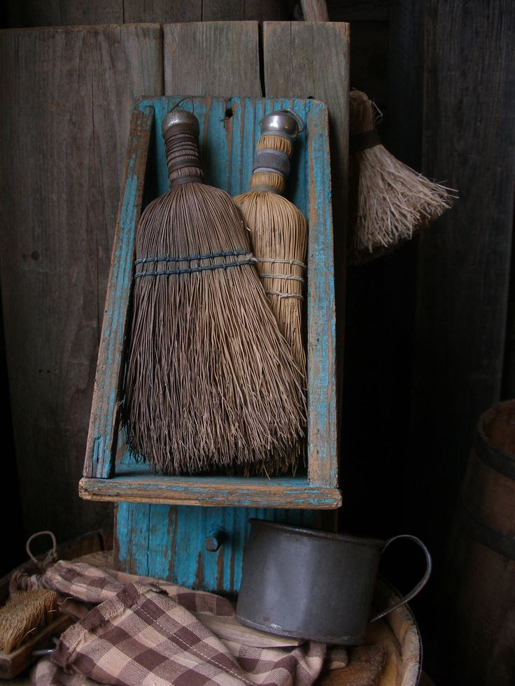 Primitive old wood broom shelf at Sweet Liberty Homestead. Great to display old hand brooms.