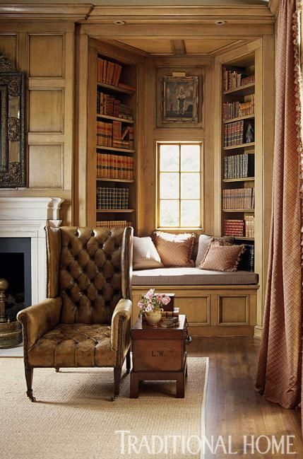How handsome! A cozy window seat surrounded by book-lined alcoves beckons. Traditional Home ® / Photo: Colleen Duffley / Design: Jane Hoke