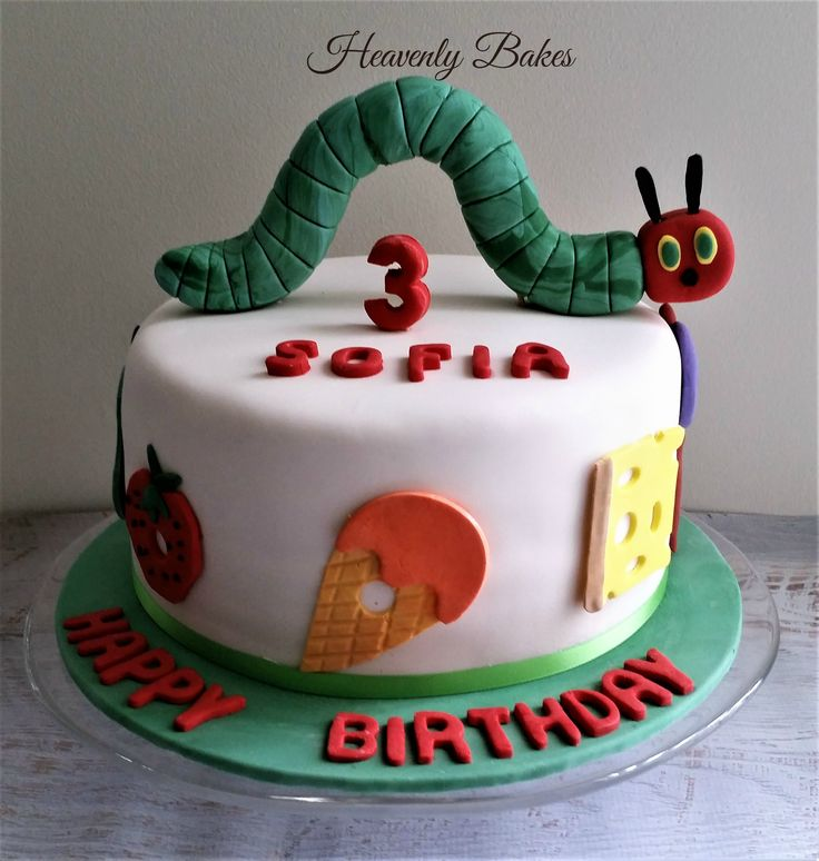 Hungry Hungry Caterpillar Cake complete with caterpillar topper and food. heavenlybakesaltona@gmail.com