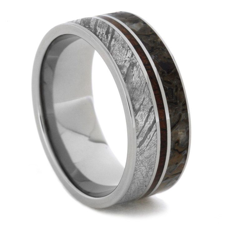 Stunning Extraordinary elements align in this magnificent meteorite wedding band Mirrored to the meteorite is genuine dinosaur bone from the Jurassic Era