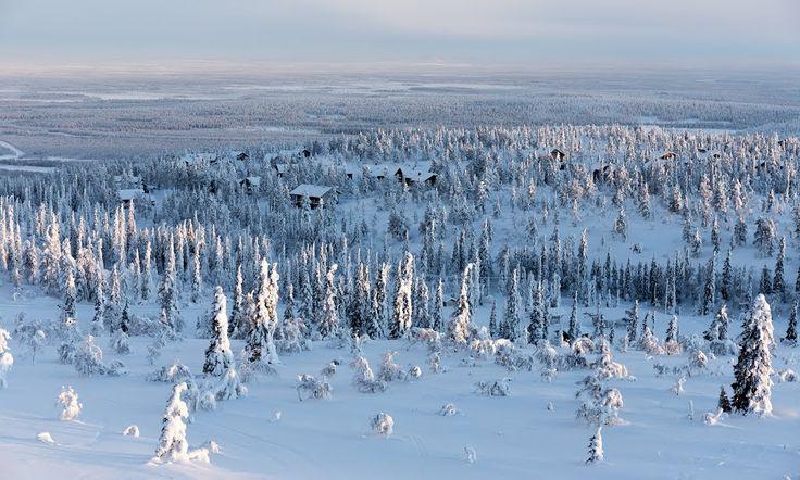 Finland, Utsuvaara ski lodges in sunrise, gold mine on the background - photo heinakenka
