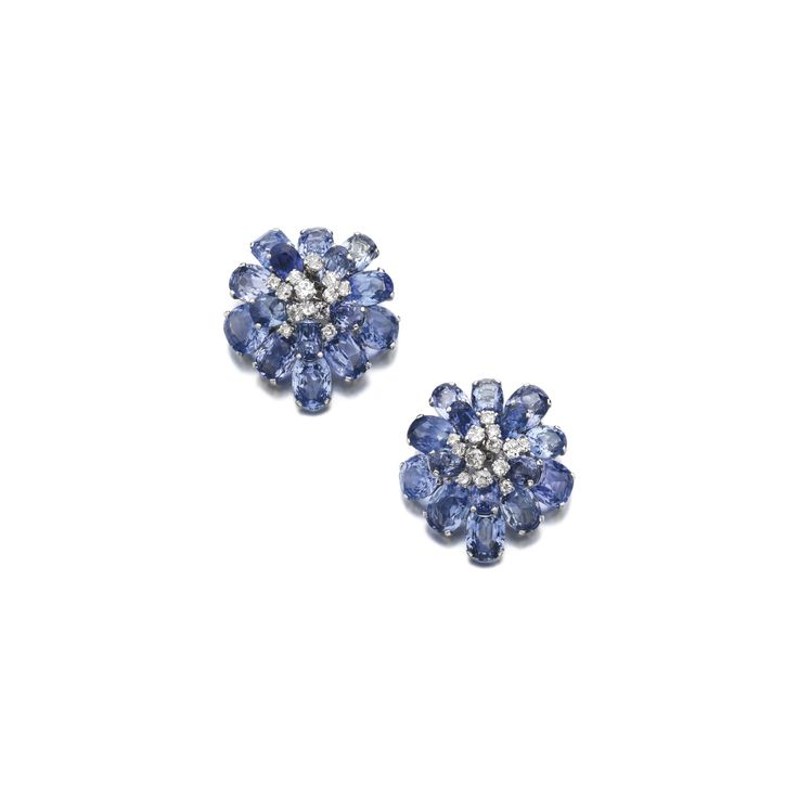 Pair of sapphire and diamond clips/bangle combination, CartierEach clip of floral design set with oval and cushion-shaped sapphires highlighted with brilliant-cut diamonds, may be worn as a bangle with an additional fitting, inner circumference approximately 185mm, signed Cartier, French assay marks, case signed Cartier.