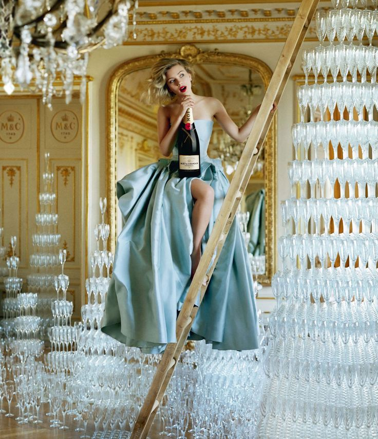 Moet & Chandon, the exclusive champagne of the Oscars.    (Scarlett Johansson 2011 Advertising Campaign.)