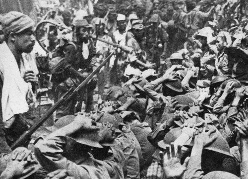 Japanese Soldiers guarding american and filipino prisoners during the battle of Bataan, 1942.