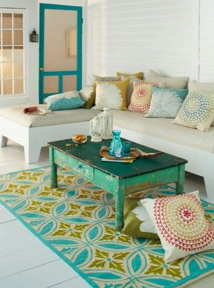 coffee table.: Coffee Tables, Living Rooms, Beaches House, Sunrooms, Color, Coff Tables, Screens Doors, Rugs, Outdoor Spaces
