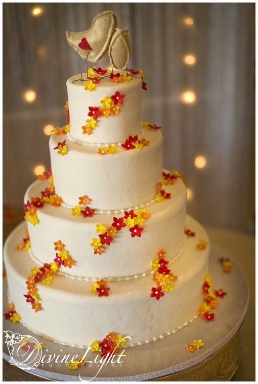 Orange, and red sugar flowers, created by Beautiful Cakes by Ron.