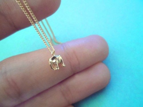 Tiniest Baby Elephant on Gold Plated Chain  This elephant is really small yet has everything from eyes to 4 legs  very delicate work   comes with sturdy finest 15 gold plated chain  Adorable Necklace