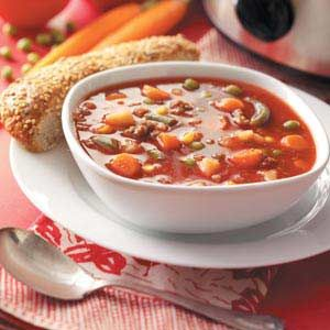 "Slow-Cooked Beef Vegetable Soup Recipe -Convenient frozen veggies and hash browns make this meaty soup a snap to mix up. Simply brown the ground beef, then stir everything together to simmer all day. ""It's wonderful served with bread and a salad,"" adds Carol Calhoun of Sioux Falls, South Dakota."