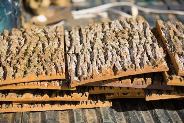 Here's a siding material you don't see everyday, tree bark. Bark siding is available as a natural or engineered product from BarkClad.
