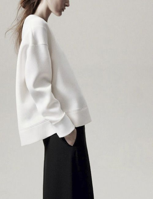 minimal silhouette - baggy white sweater and black pants