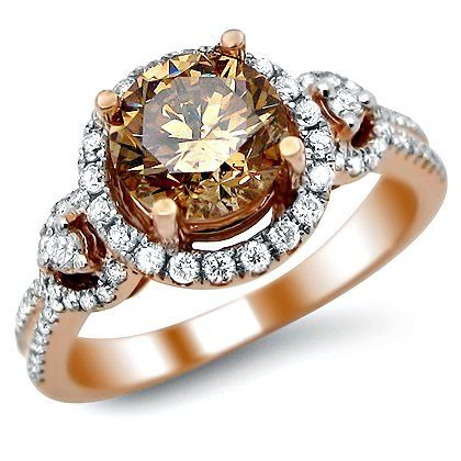 Fancy Brown Round Diamond Engagement Ring - A very stunning 1.92 carat Fancy Brown Round Diamond Engagement Ring set in 14k Rose Gold. It features a sparkling brilliant cut 1.27 carat Solitaire Brown Diamond is placed atop of the item. It also comes with lovely .65 carats of round diamonds that surround the top of the ring & are set down each side. They are an SI1 in clarity stones that are prong set. It measures 10mm wide at its point. The diamonds are 100% natural. #unusualengagementrings