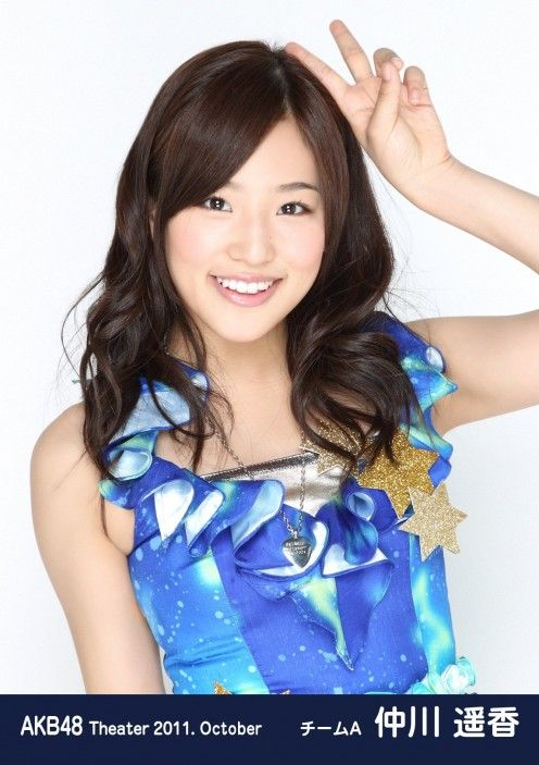 Haruka Nakagawa is dressed in traditional clothing that these Japanese idols must wear when they are on stage.