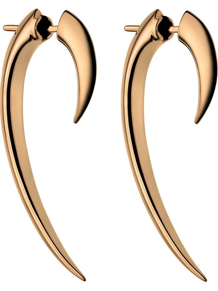 SHAUN LEANE 'Tusk' earrings. First created for the Alexander McQueen catwalk show 'The Hunger' in 1995. This is now Shaun Leanes signature motif.
