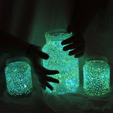 painted dots with glow in the dark paint on mason jars for night time party outside on the deck