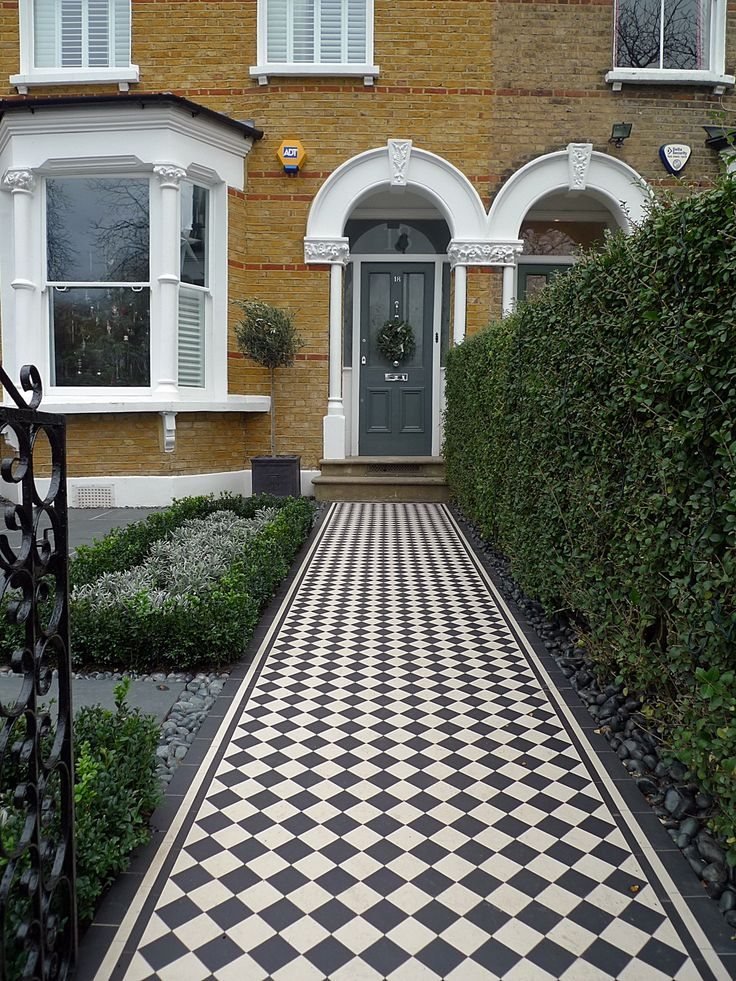 Share Tweet Pin Mail Front garden Victorian Tile topairy bike bin store mosaic black and white wall West London Putney Sheen Richmond Ham London Contact anewgarden for more information