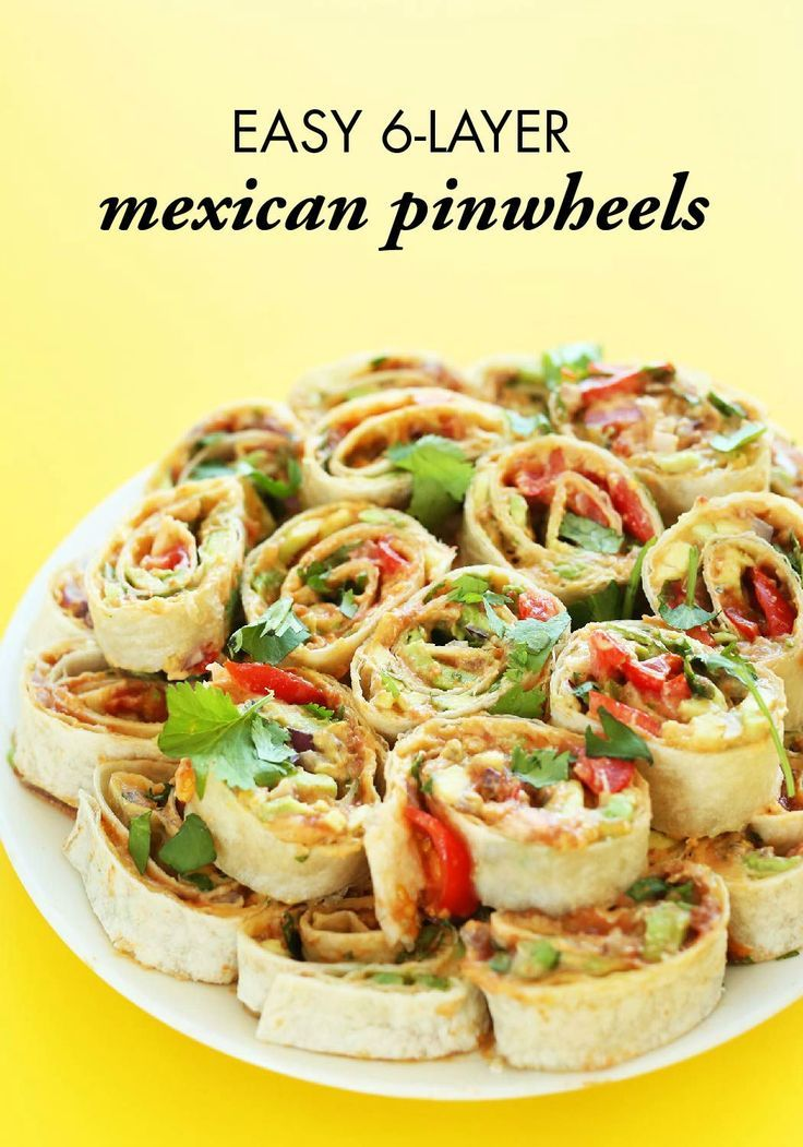 6-Layer Mexican Pinwheels are an easy and amazing appetizer recipe. With refried beans, avocado, and cheese, it's a delicious finger food that's sure to disappear quickly at any occasion.