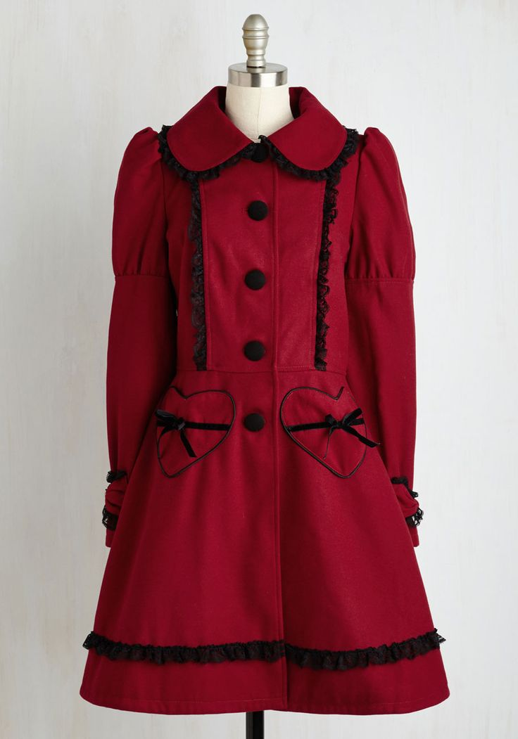 Frill Power Coat. Just try to resist the delightful assortment of accents that detail this deep red coat - we dare you! #red #modcloth