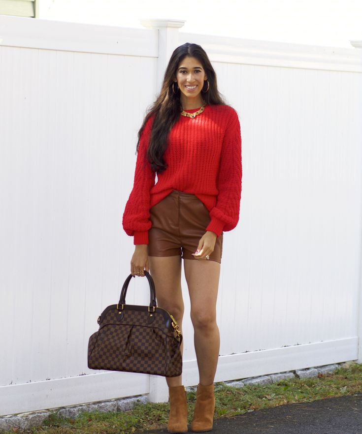 red color trend, how to wear red, red outfit ideas, what colors look good with red, fall outfit ideas, how to wear brown, what colors look good with brown, brown leather shorts, red balloon sleeve sweater, red cable knit sweater, 90s outfit ideas, the style contour, the best red shade for my skin tone    Sweater | Shorts: Similar here, here | Necklace: Similar | Boots c/o | Bag: Louis Vuitton     //  JavaScript is currently disab