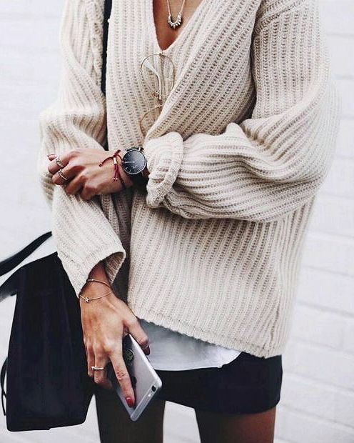 Toasty: thick knitted creamy sweater oversized with a black a line mini skirt. The perfect fall outfit.