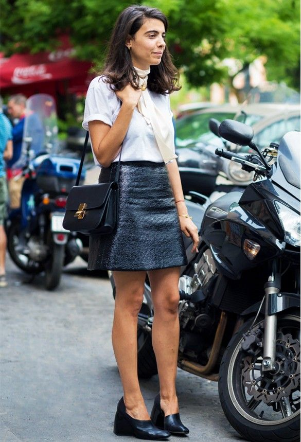 Textured leather mini skirt, cuffed sleeve whit t-shirt, beige scarf, and black wedged heels.