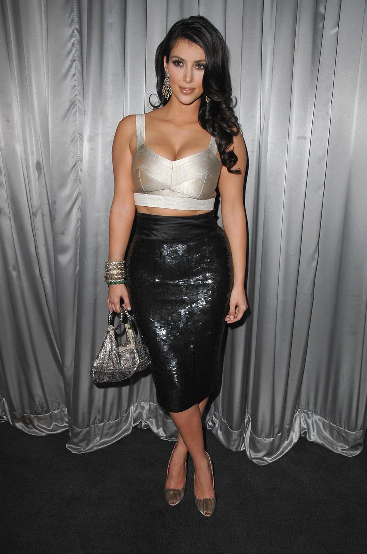Kim wore a cropped bustier and high-waisted sequin skirt in