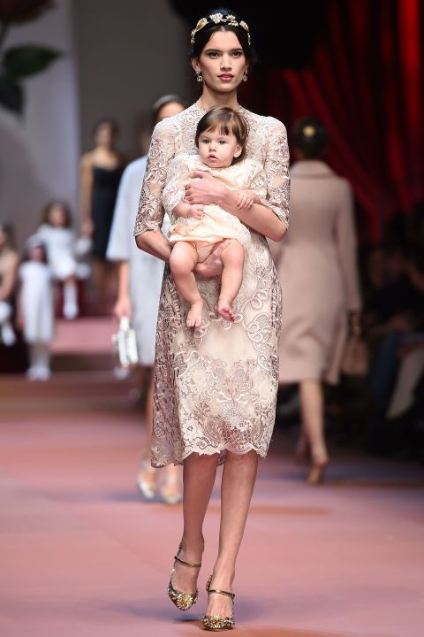 At heart, Domenico Dolce and Stefano Gabbana are mamma's boys. Their Fall runway a literal celebration of mamma mia, from model Bianca Balti and her baby bump to other women carrying sweet cherubs (low blow on the awwww scale, fellows!). And the clothes lived up to the ideals of Italian motherhood. If not exactly matronly, it certainly played into archetypes.