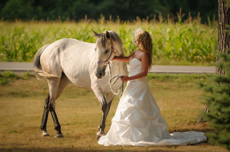 Wedding Dresses and Horses, the best combination.