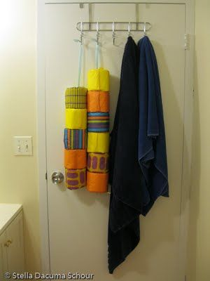 I thought this was such a creative way of storing toilet paper. I wouldn't go as far as wrapping it like she did here, but behind the door on a ribbon sounded do-able.