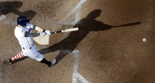 TOP VIEW: The Brewers' Eric Sogard hits a single against the Orioles on July 4 in Milwaukee. The Brewers won 6-2.