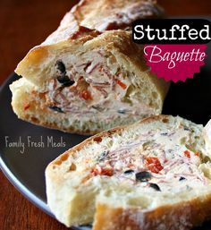 Stuffed Baguette -  Makes about 24 slices -baguette about 14 inches long (the one pictured is double that) - 8oz of cream cheese brought to room temp - 4 oz goat cheese - 1/4 cup each of green olives & black olives - 2 cloves minced garlic - 2 tbsp of chopped fire roasted peppers - 1 tsp dried parsley (if you have fresh, do 1 TBSP)