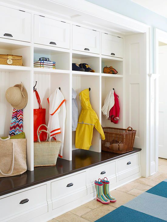 A Place for Everyone    Entryway    Cut down on entryway clutter by giving each family member a personalized drop zone for coats, hats, bags, and more. This built-in unit combines open cubbies with closed cabinetry for stowing seasonal accessories out of sight. The base of the cabinet extends outward to create a bench that's perfect for putting on and taking off shoes.