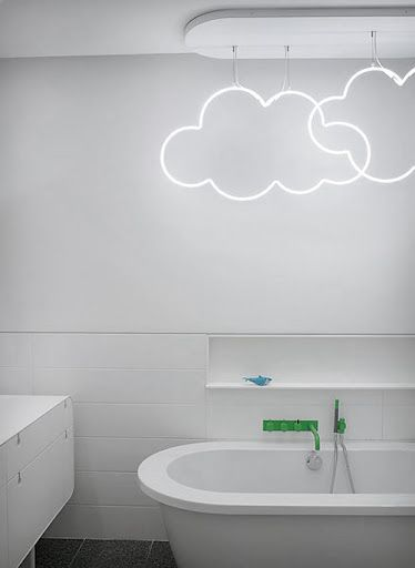 a bathroom with neon clouds