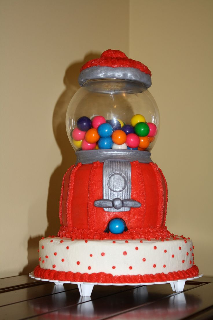 Gumball Machine - Carved cake with glass globe to hold real gumballs.  Used buttercream icing and some fondant accents.