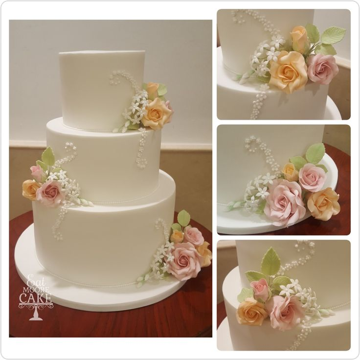 Simple elegant floral white wedding cake with blush peach sugar flowers