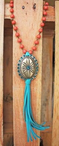 Bronze Blue zircon sunburst concho on long coral beaded necklace with turquoise leather tassel.      Classy Cowgirl Co- Gypsy Cowgirl ,Fun & Funky Western c