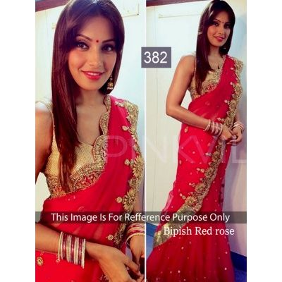 Lead the fashion pack this festive season by draping this Red saree by Jomso. Featuring a striking embellishment Bollywood work, this aesthetic wonder will surely put you in the limelight. Team this Georgette saree with statement jewellery to stand out in the crowd. It measures 6.30 m in length, including a 0.80 m blouse piece.
