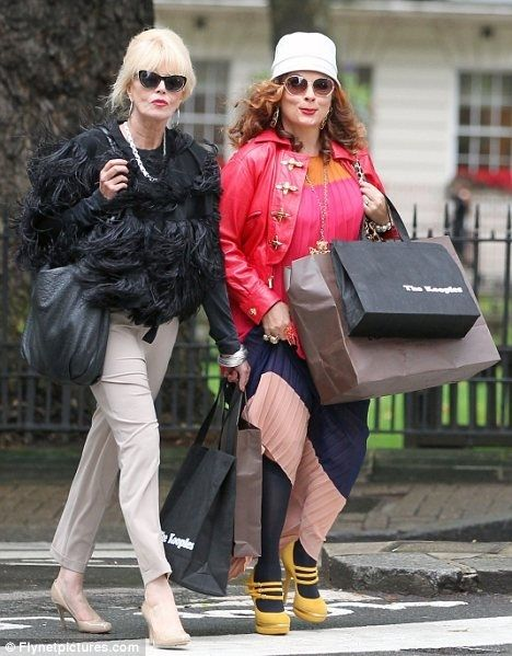 Eddy and Patsy shopping -- layered colors & crazy shoes on Eddy, sleek high fashion on Pats